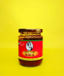 saucy-wench-chilli-oil. Saucy Wench's most popular condiment, our chilli oil is vegan and packed with roasted chilli flakes. Perfect for dumplings, noodles and fried rice or to marinade on meat before slapping it on the BBQ!